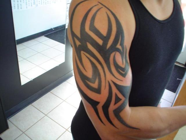 tribal half sleeve tattoos,tribal half sleeve tattoo designs,tribal half sleeve tattoos for men,men half sleeve tribal tattoo designs