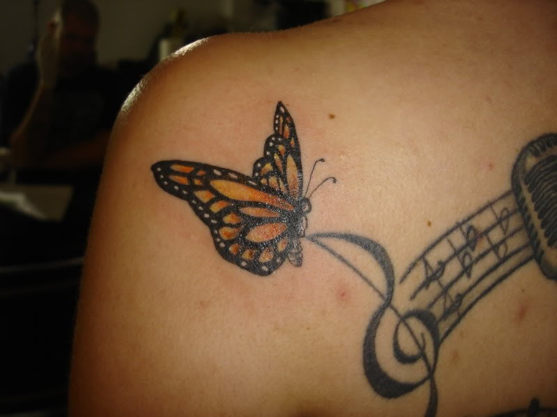 Celebrities with butterfly tattoos designs for Butterfly tattoos gallery