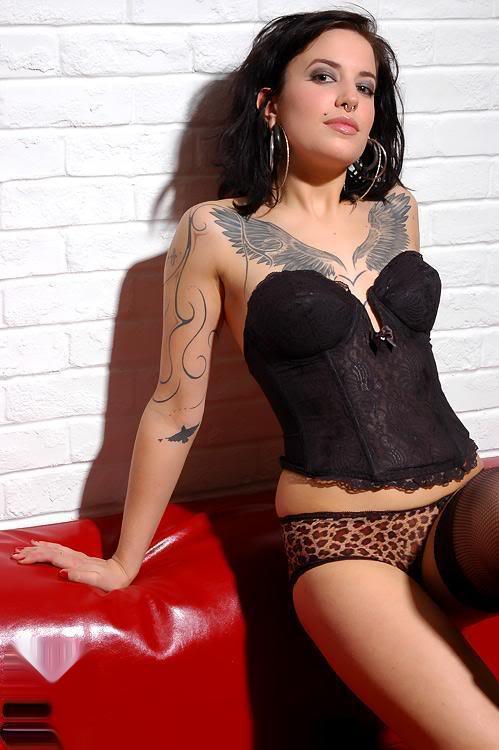tribal chest tattoo,girls chest tattoo design,chest tattoos for women,popular tattoo designs for chest,flower chest tattoo designs