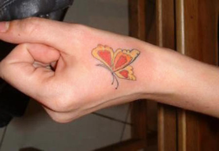 butterfly hand tattoo designs,butterfly hand tattoos for women,hand tattoo designs,tattoo of butterfly on hand