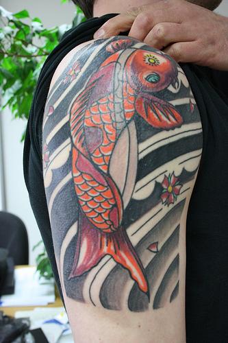 japanese sleeve tattoos, koi fish tattoos on sleeve,koi fish sleeve tattoos,koi half sleeve tattoo designs