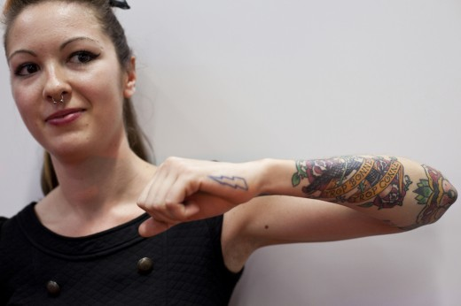 women arm tattoo designs,arm tattoos for women,popular arm tattoos for women,women arm tattoos ideas,arm tattoos for girls images