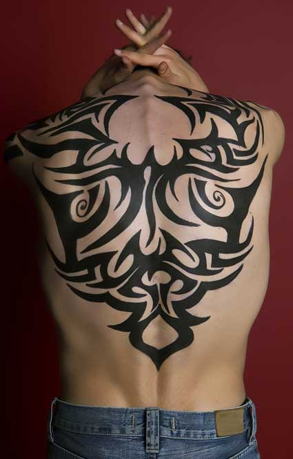 back tribal tattoo designs,tribal tattoos on back,tribal tattoo designs for men back,back tribal tattoos ideas