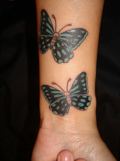 butterfly wrist tattoos meanings. Black Bedroom Furniture Sets. Home Design Ideas