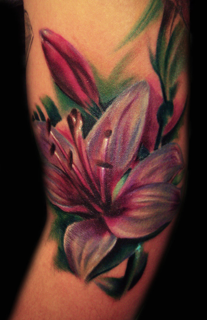 Lily tattoos since the lily flower is widely used in a variety of different cultures over the ages their symbolic meaning can differ between cultures izmirmasajfo Choice Image