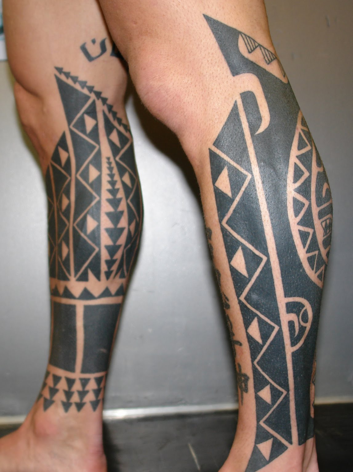 Tribal leg tattoos for Thigh sleeve tattoo