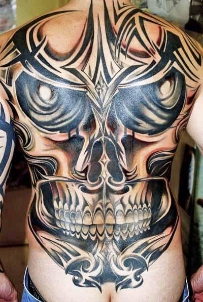 tribal skull back tattoos. Black Bedroom Furniture Sets. Home Design Ideas