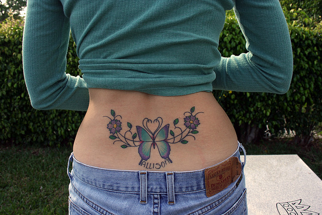 Flower and Butterfly Lower Back Tattoo Designs